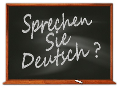 "tablica, a na na niej napisane kredą "" Sprechen sie Deutsch?"""